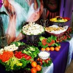 veggie and fruit trays with pin wheels and bread